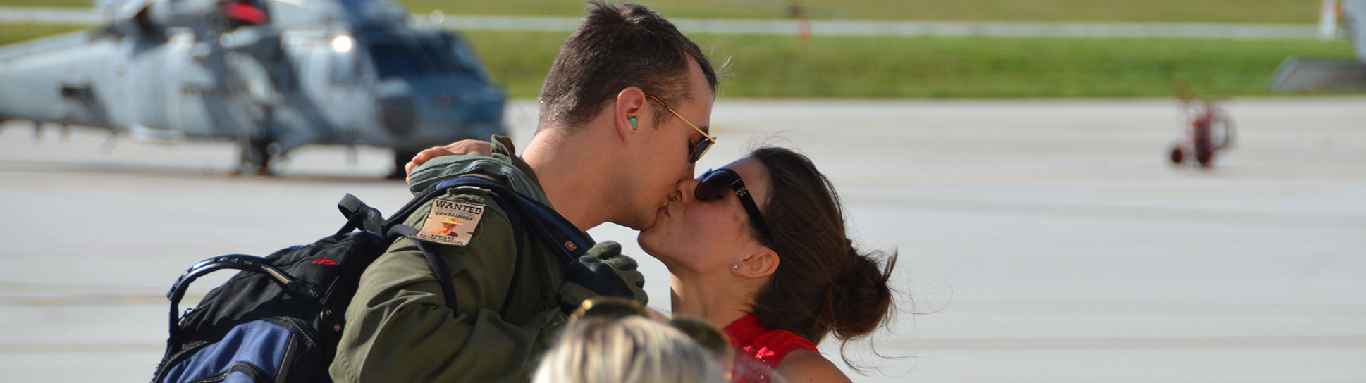 Lt. Scott Brady reunites with his wife Brittany after Helicopter Sea Combat Squadron (HSC) 25 Det 1 returned from a seven-month deployment in the Indo-Asia-Pacific region. (U.S. Navy/John McSorely)