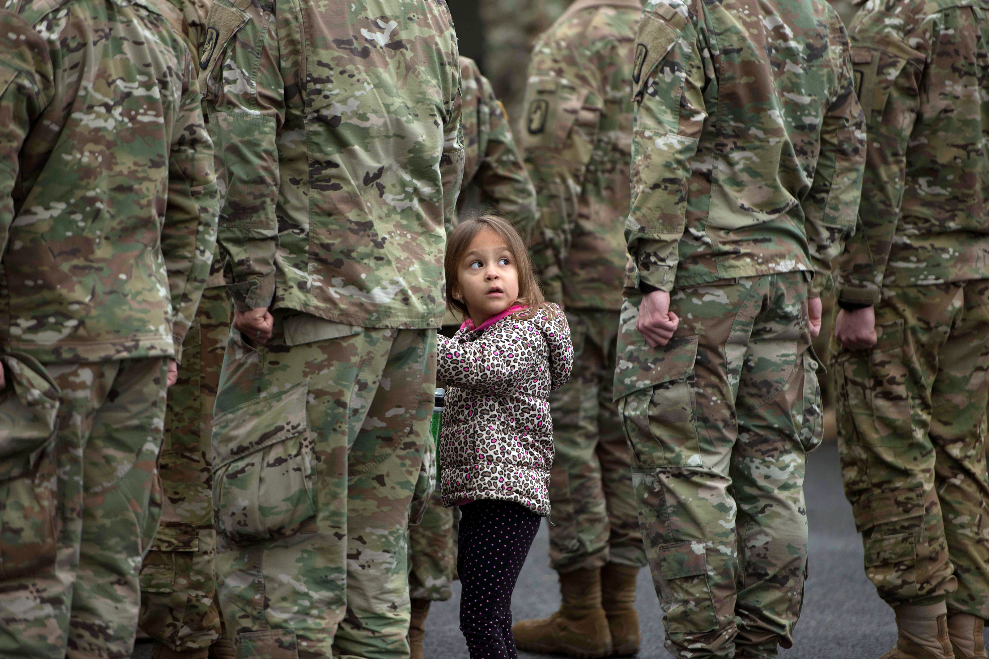 "A little girl holds her father's hand during the 1-214th GSAB annual ""Family Safety Day"" in Hessen, Germany. (U.S. Army/Paul Hughes)"