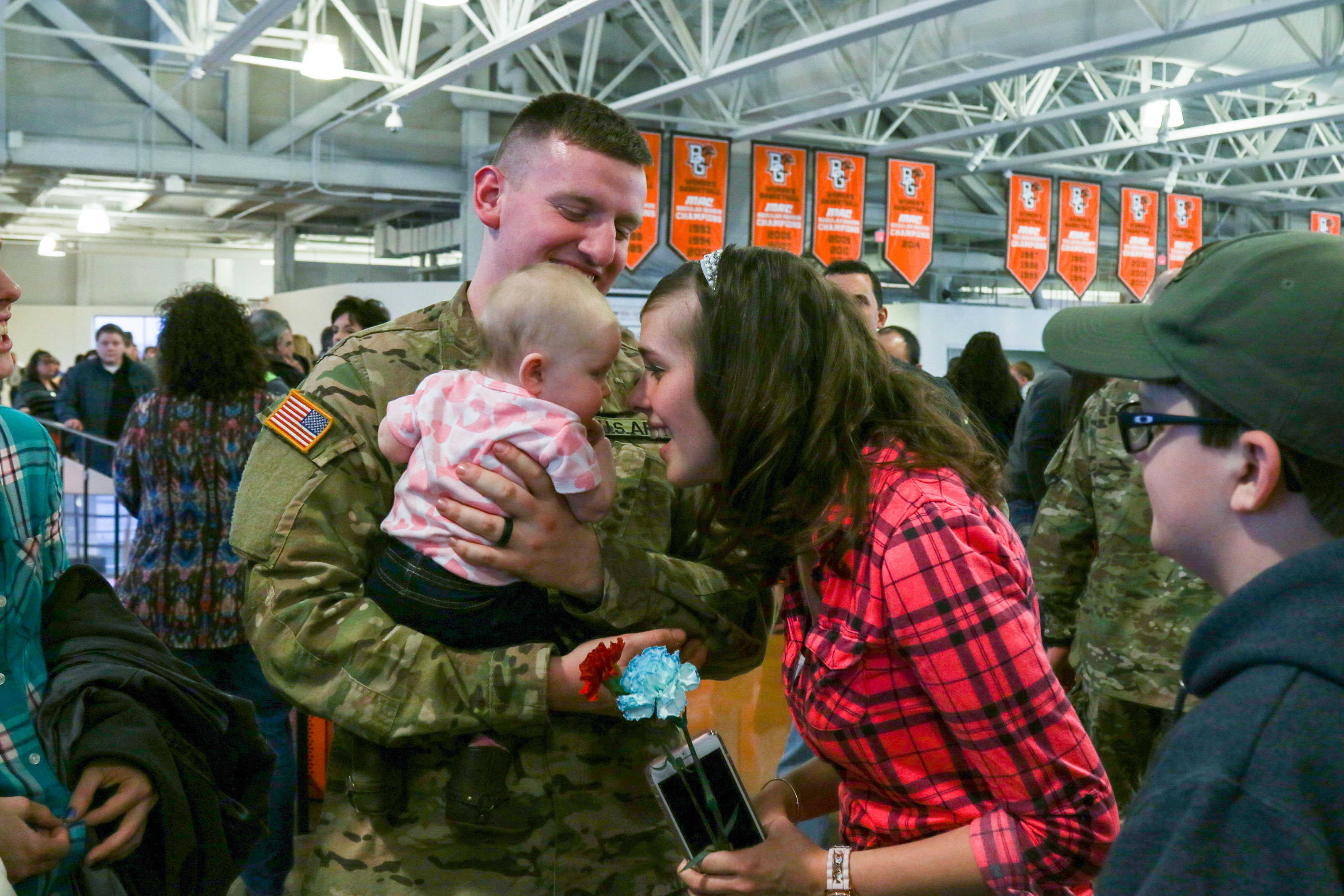 A  Soldier assigned to the 1st Battalion, 148th Infantry Regiment spends time with his Family after the unit's call to duty ceremony Jan. 11, 2017, in Bowling Green, Ohio.  (Ohio National Guard/ Michael Carden)