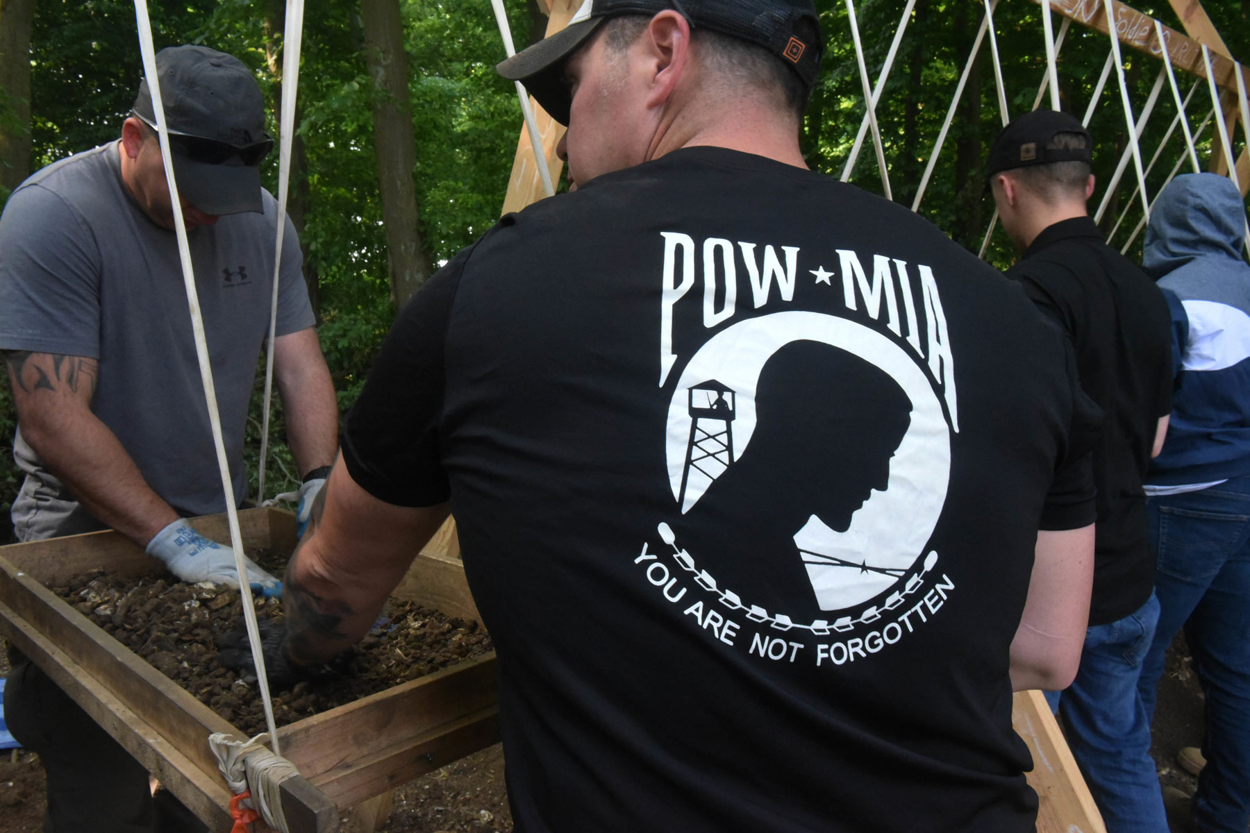 U.S. Army Sgt. 1st Class Nathan Fair, with the Defense POW/MIA Accounting Agency (DPAA) dry screens soil in search of remains in Boussicourt, France, May 22, 2018. (U.S. Army photo by Staff Sgt. Richard DeWitt)