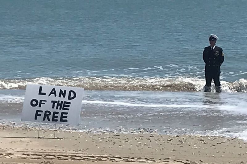 Man Wearing US Navy Uniform Protests Beach Closure...