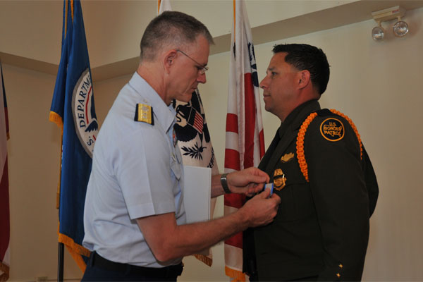 coast guard awards medal to border patrol agent