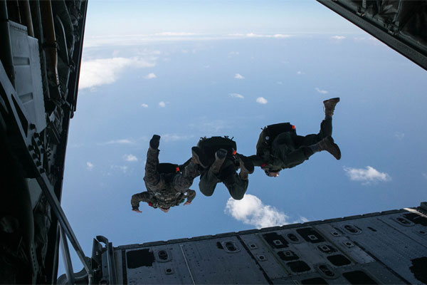 recon marines prepare for parachute missions in pacific