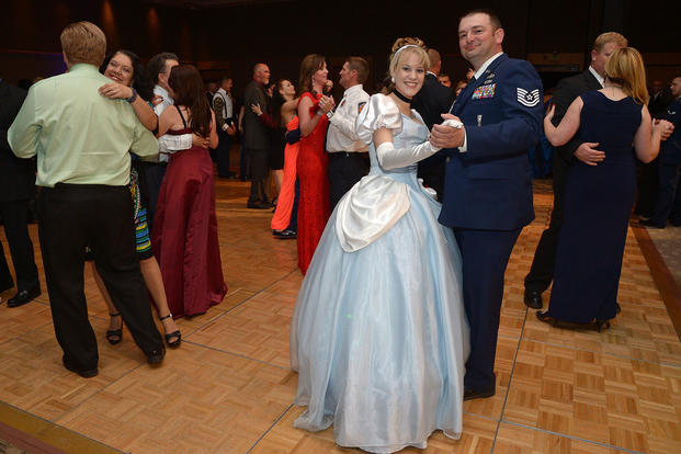 Ali Arbuckle, dressed as Cinderella, and her date retired Tech. Sgt. Rudolf Horak dance during the Hill Air Force Base Air Force Ball. (U.S. Air Force/Alex R. Lloyd)