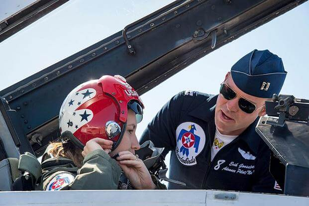 "Capt. Erik ""Speedy"" Gonsalves, pilot of Thunderbird 8, helps Military.com reporter Oriana Pawlyk before an orientation flight in April. Photo: Air Force Thunderbirds"