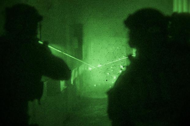 Green Berets assigned to 10th Special Forces Group (Airborne) aim down a hallway during a training exercise with Lithuanian Special Forces, Nov. 13, 2017, in Eastern Europe. (U.S. Army/Spc. Christopher Stevenson)