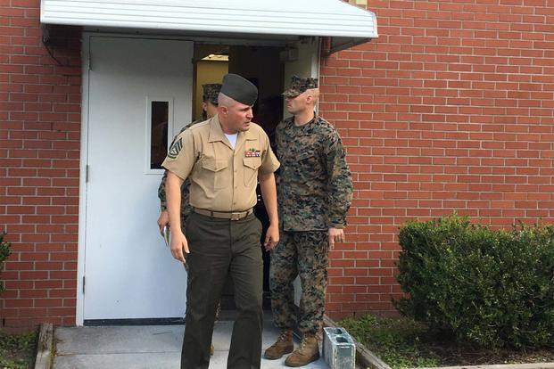 Gunnery Sgt. Joseph Felix exits a military courthouse at Camp Lejeune, N.C., after being sentenced to 10 years in prison for hazing Muslim recruits. (Photo by Hope Hodge Seck/Military.com)