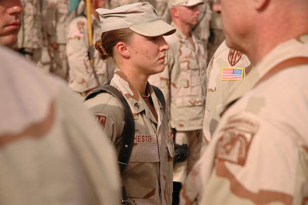 Sgt. Leigh Ann Hester stands at attention before receiving the Silver Star. (U.S. Army/Spc. Jeremy D. Crisp)