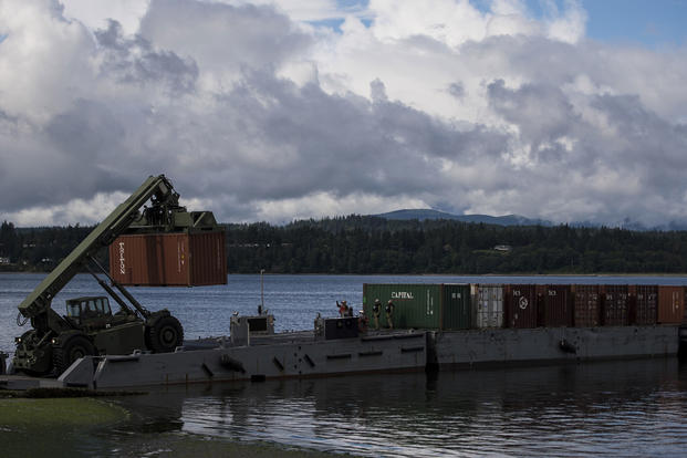 U.S. Navy sailors unload cargo containers from an Improved Navy Lighterage System Causeway Ferry during Joint Logistics Over-the-Shore 2016, June 14, 2016 on Naval Magazine Indian Island, Wash. (U.S. Air Force photo/Staff Sgt. Kenneth W. Norman)