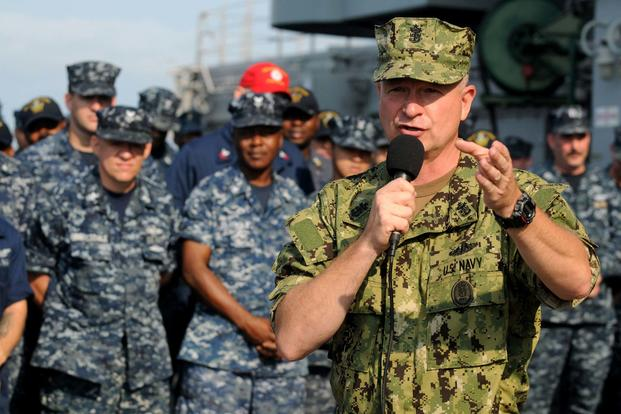 Master Chief Petty Officer of the Navy Rick West holds an all-hands aboard the USS Kearsarge during a visit to Naval Station Norfolk. West is wearing the Navy Working Uniform Type III. (Petty Officer 1st Class Jennifer Villalovos/U.S. Navy)