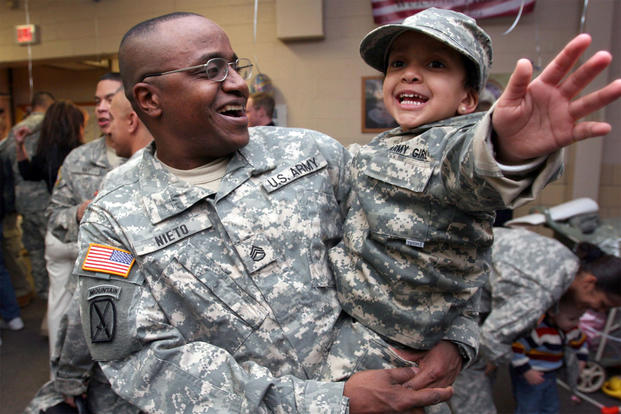 Staff Sgt. Antonio Nieto, 50th Personnel Services Battalion, New Jersey Army National Guard, laughs with his daughter, Antonella, after returning from a year-long tour in Afghanistan in support of Operation Enduring Freedom on Joint Base McGuire Dix-Lakehurst, New Jersey  in 2007. (U.S. Air National Guard/Mark Olsen)