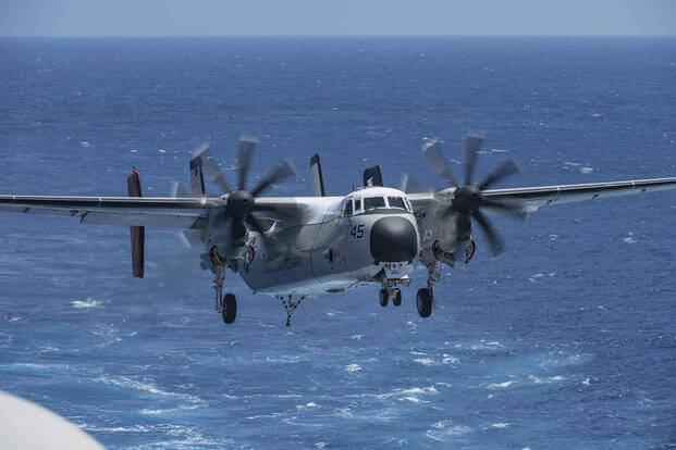 "A C-2A Greyhound assigned to the ""Rawhides"" of Fleet Logistics Squadron (VRC) 40 lands on the aircraft carrier USS George H.W. Bush (CVN 77) on July 19, 2017. Mass Communication Specialist Seaman Darien Weigel/Navy"