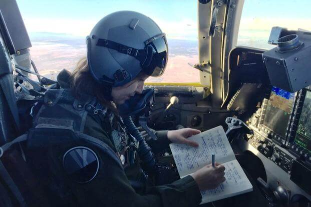 Military.com reporter Oriana Pawlyk takes notes during a B-1 training mission, Dec. 19, 2017. (Photo by Maj. Charles Kilchrist, 9th Bomb Squadron)