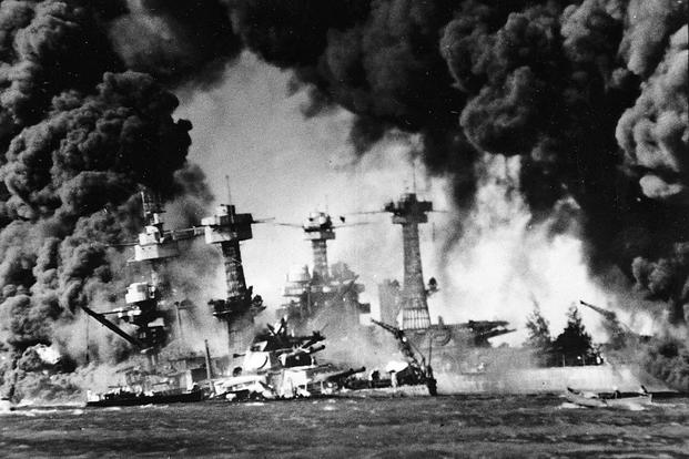 The battleship USS West Virginia engulfed in flames and smoke during the attack on Pearl Harbor on Dec. 7, 1941. Photo via the Department of Veterans Affairs