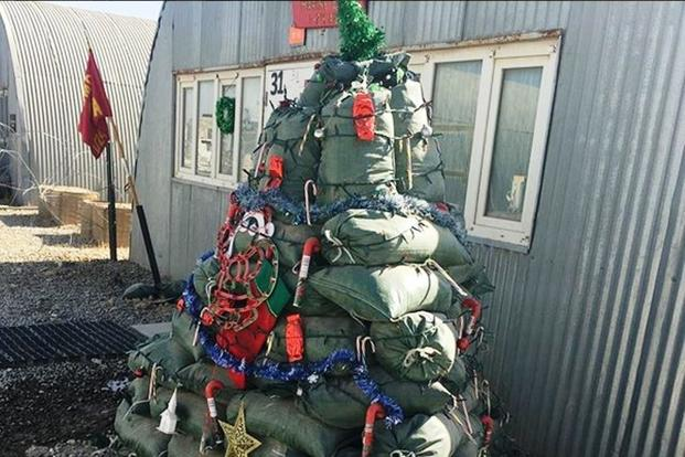 Marines are getting in the Christmas spirit in Helmand Province, Afghanistan. Check out this amazing sandbag Christmas tree! (Photo by Hope Hodge Seck/Military.com)