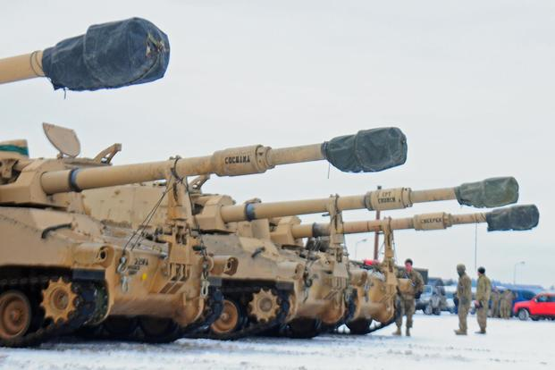 M109 Paladin self-propelled howitzers belonging to 3rd Battalion, 29th Field Artillery Regiment, 3rd Armored Brigade, 4th Infantry Division offloaded from a flatcar railway in Poland, Jan. 9, 2017. (U.S Army/ Staff Sgt. Corinna Baltos)