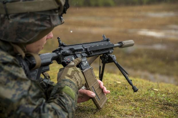 A member of 3rd Battalion, 8th Marines, fires the M27 Infantry Automatic Rifle during a live-fire weapons exercise on Camp Lejeune, N.C., on Dec. 8, 2017. (U.S. Marine Corps photo by Lance Cpl. Michaela R. Gregory)