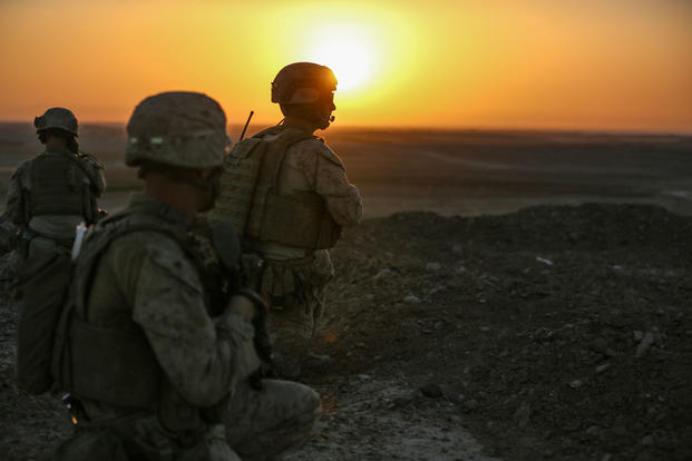U.S. Marines with 2d Platoon, Bravo Company, 1st Battalion, 2d Marine Regiment, observe surrounding compounds during a security patrol in Washir District, Helmand Province, Afghanistan on September 29, 2014. (U.S. Marine Corps photo/John A. Martinez Jr.)