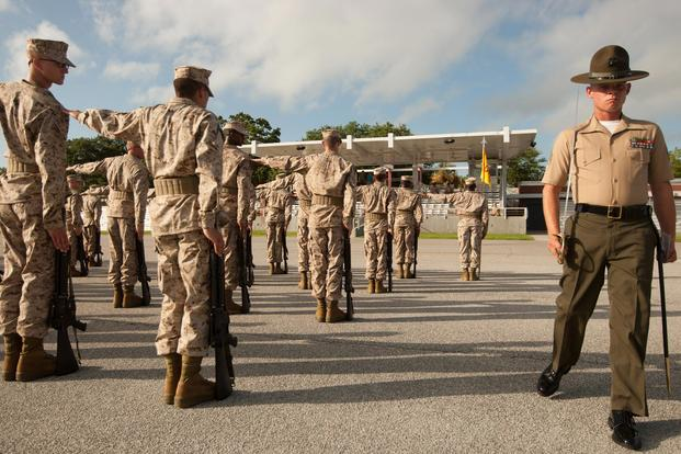 Sgt. Michael Eldridge, a drill instructor for Platoon 3070, Lima Company, 3rd Recruit Training Battalion, steps into place for the initial drill evaluation July 15, 2013, on Parris Island, S.C. (Photo by Cpl. Caitlin Brink)