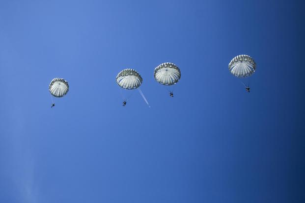 FILE PHOTO -- Static-line parachutists descend from the sky during International Jump Week 2017 near Bitburg, Germany, July 13, 2017 (U.S. Marine Corps/Cpl. Jodson B. Graves)