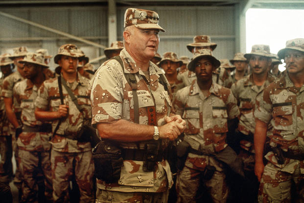 U.S. Army Gen. Norman H. Schwarzkopf, commander of U.S. Central Command, speaks to U.S. soldiers inside a hangar while visiting a base camp during Operation Desert Shield, April 1, 1992.(Defense Department)