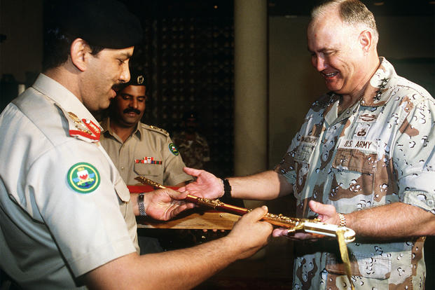 Bahraini Defense Minister Maj. Gen. Shaikh Khalifa Bin Ahmed Al-Khalifa presents U.S. Army Gen. Norman Schwarzkopf with a sword in recognition of his role in the allied success during Operation Desert Storm, March 26, 1991. (U.S. Army/Dean Wagner)