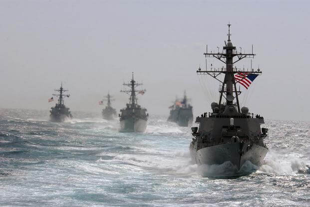 The guided missile destroyer USS Porte (right) leads the way during divisional tactics training along with the USS McFaul, USS Arleigh Burke and USS Cole, and the guided missile cruisers USS Cape St. George and USS Anzio in the Atlantic Ocean, on March 5, 2005. (U.S. Navy/ Lt. j.g. Caleb Swigart)