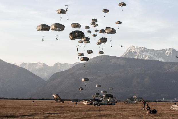 The skies of northern Italy are filled with paratroopers from the 173rd Airborne Brigade as hundreds of paratroopers conduct a tactical airborne insertion onto Juliet Drop Zone on Jan. 24, 2018. Lt. Col. John Hall/Army