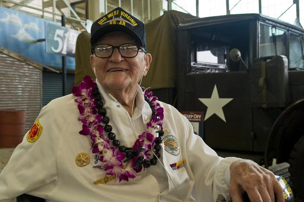 "Pearl Harbor survivor and retired Navy Lt. Jim Downing attends a screening of the ""Remember Pearl Harbor"" documentary at the Pacific Aviation Museum at Pearl Harbor, Hawaii, on Dec. 4, 2016. DoD photo by Lisa Ferdinando"