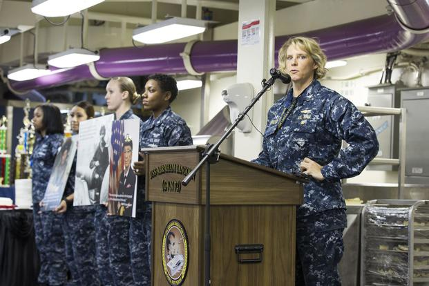 Capt. Amy Bauernschmidt, executive officer of the Nimitz-class aircraft carrier USS Abraham Lincoln (CVN 72) speaks during the Women's History Month observance on the ship's mess deck. (U.S. Navy/Mass Communication Specialist 3rd Class Juan Cubano)