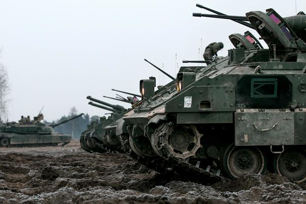 U.S. Army M2 Bradley Fighting Vehicles assigned to Company C, 2nd Battalion, 70th Armored Regiment, 2nd Armored Brigade Combat Team, 1st Infantry Division, based at Fort Riley, Kansas, idle on the fields of Presidenski Range in Trzebian, Poland, during a platoon combined arms live fire exercise (CALFEX) on March 26, 2018. The Army is developing the Next Generation Combat Vehicle to replace Bradley Fighting Vehicles and M1 Abrams tanks. (U.S. Army photo by Spc. Dustin D. Biven)