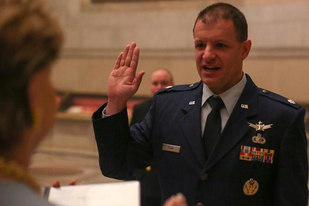Lieutenant Colonel Bryan (Bree) Fram is an active duty astronautical engineer and transgender service member in the US Air Force promoted at the National Archives and reaffirming his oath administered by Congresswoman Madeleine Bordallo (D-GU). (SPC S. NIC MALONE - U.S. ARMY)