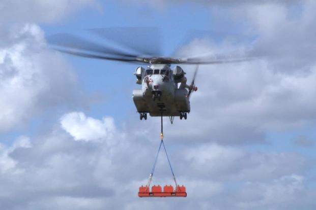 The Sikorsky CH-53K helicopter achieves a 36,000-pound lift for the first time at Sikorsky Development Flight Center in West Palm Beach, Florida, on Feb. 10, 2018. (Image courtesy Sikorsky, a Lockheed Martin Company)