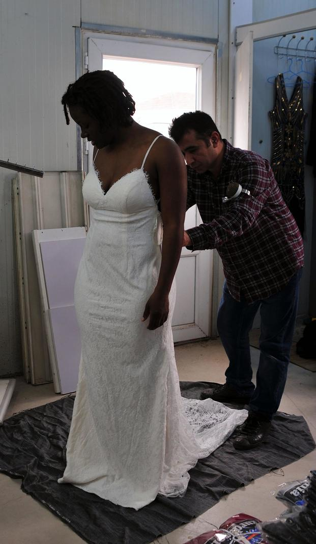 Texas Army National Guard Sgt. Cillia Edwards has her wedding dress altered at a local tailor shop on post on Dec. 22, 2017. Staff Sgt. Elizabeth Pena/Army