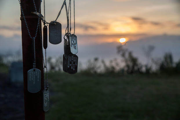 Dog tags from Marines and Sailors are found atop Mount Suribachi in honor of their fallen comrades during the 73rd Reunion of Honor. (U.S. Marine Corps photo/Hannah Hall)