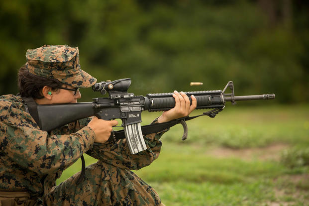 Rct. Elizabeth C. Villegas, Platoon 4026, Oscar Company, 4th Recruit Training Battalion, shoots during marksmanship training June 21, 2017, on Parris Island, S.C. (U.S. Marine Corps photo/Joseph Jacob)
