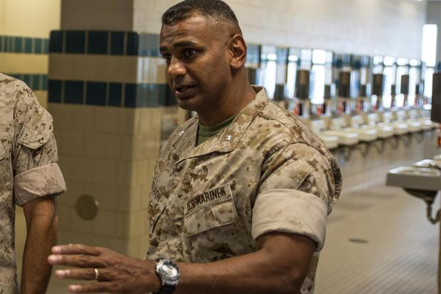 FILE -- Lt. Col. Joshua Kissoon, commanding officer of 3rd Recruit Training Battalion, gives a tour of the 3rd Battalion barracks, Oct. 9, 2014, on Parris Island, S.C. (Photos by Cpl. David Bessey)
