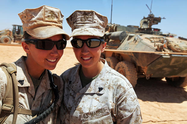 Cpls. Chandra House, left, and Chayna Blackwood, right, identical twins from Houston, Texas, pose for a photo, May 22, 2012. (U.S. Marine Corps/ Richard Blumenstein)