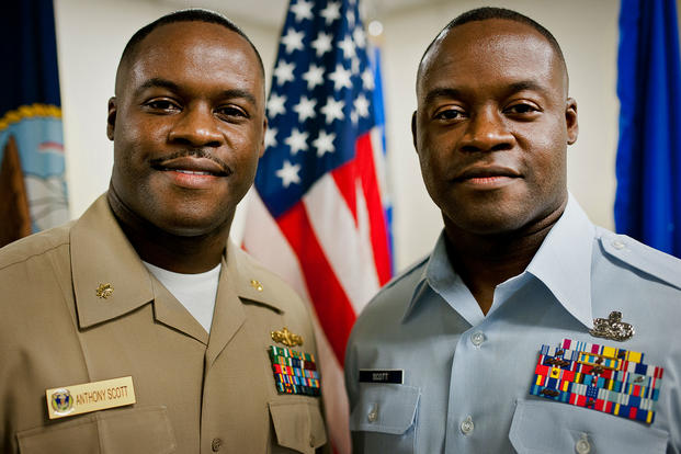 Navy Lt. Cdr. Anthony Scott stands with his twin brother Master Sgt. Antone Scott, 96th Logistics Readiness Squadron, after administering the oath of enlistment to him June 27 at Eglin Air Force Base, Fla. (U.S. Air Force/Samuel King Jr.)