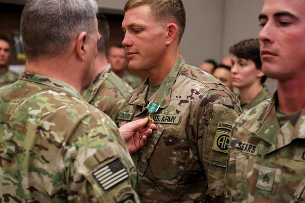 Gen. Mark Milley, chief of staff of the Army, pins an Army Commendation Medal with V device on Sgt. Mark Andrisek at Bagram Air Field, Afghanistan, on Dec. 19, 2017. (US Army photo/Juan Munoz)