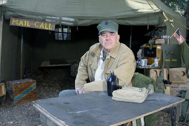 "Retired Honorary Gunnery Sgt. R. Lee Ermey sits on the set of ""Mail Call"" (Photo courtesy of History Channel)."