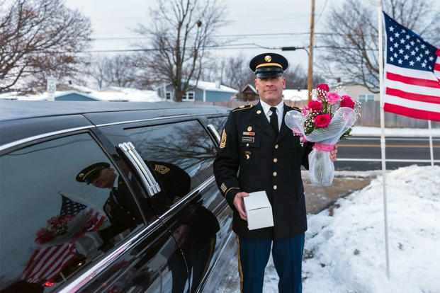 Illinois National Guard 1st Sgt. Joseph Bierbrod arrives at the Hinton's home to ask Cayleigh Hinton if he can escort her to the Father-Daughter. Cayleigh's father, Sgt. Terrence Hinton, died in a 2017 training accident. (Illinois National Guard/Staff Sgt. Robert R. Adams)