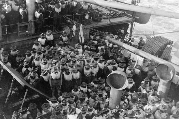 (1917-1918) Troops wearing life preservers on deck, while passing through the submarine zone, en route to France during World War I. These Soldiers appear to be members of an African-American unit. (Photo: U.S. Naval History and Heritage Command)