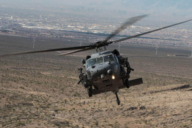 An HH-60G Pave Hawk helicopter, assigned to the 66th Rescue Squadron, flies during training on Nellis Air Force Base, Nevada, Feb. 22, 2018. (U.S. Air Force phoo/Kevin Tanenbaum)
