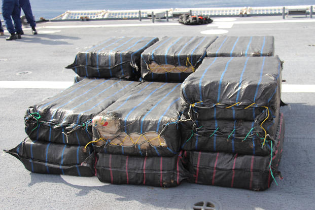 Bales of cocaine, seized in international waters of the Eastern Pacific Ocean from a suspected smuggling vessel by the crew of the Coast Guard Cutter James, lie stacked on the cutter's deck, April 17, 2018. (U.S. Coast Guard photo)
