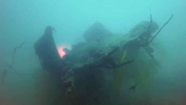 "The underwater crash site of Navy Lt. William Punnell and his F6F ""Hellcat."" Investigators with the Defense Department and Project Recover found the site in 2014 off the coast of the Republic of Palau and recovered Punnell's remains. (Photo courtesy of Project Recover)"