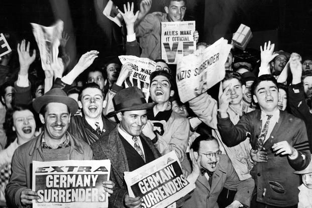 In Chicago, celebrators take to the streets during V-E Day on May 8, 1945. (historical photo)