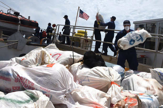 The crew of the Coast Guard Cutter Thetis offloads approximately 2,116 pounds of marijuana after returning to homeport in Key West, Florida, Friday, June 8, 2018. In March, Thetis crewmembers alongside an MH-65 Dolphin helicopter crew from Air Station Borinquen, Puerto Rico, and a Jamaican Defence Force crew interdicted a suspected drug smuggling vessel in the Caribbean. (U.S. Coast Guard photo/Ashley J. Johnson)