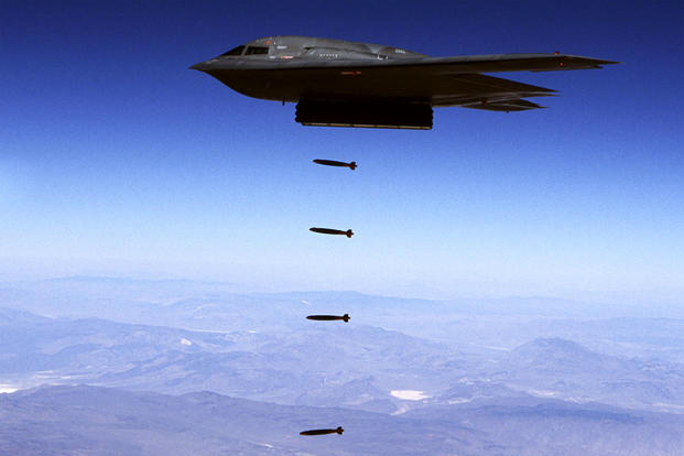 A B-2 Spirit drops inert Joint Direct Attack Munitions over the Utah Testing and Training Range at Hill Air Force Base. The bomber will soon add the B61-12 nuclear gravity bomb to its weaponry. (US Air Force photo)