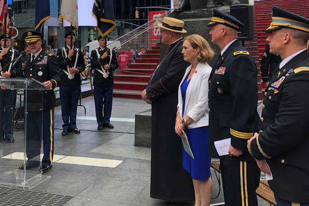 "New York Army National Guard Chaplain (Lt. Col.) Scott Ehler, left, introduces the official party to commemorate the life and career of New York Army National Guard Chaplain Father Francis P. Duffy at Times Square June 27, 2018. Ehler joined with Archbishop of New York Cardinal Timothy Dolan, WWI National Commissioner Dr. Libby O'Connell and the National Guard's senior chaplain, Chaplain (Brig. Gen.) Kenneth ""Ed"" Brandt to commemorate Duffy's service in WWI. (U.S. Army National Guard photo/Jean Kratzer)"